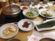 Sliced mushroom stems, kimchi peppers, pickled garlic leaves, enoki/sebal namul salad, aged kimchi, seasoned soybean sprouts, greens.