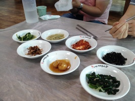 myeolchi bokkeum, napa kimchi, honey glazed potatoes, seaweed, garlicky crunchy tangy greens (like, lactofermentation tangy), other amazing things