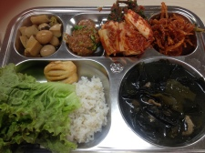 Quail eggs and mushroom stems. Ssamjang. Kimchi. Squid in sticky sauce. Seaweed and beef soup. Rice, lettuce, apple pastry,