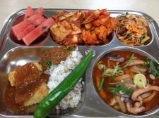 Tofu donkkaseu. Rice, peppers, napa and radish kimchi, watermelon. Cabbage, apple, spaghetti salad. Tentacle soup.