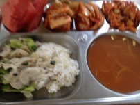 Blurry af photo of watermelon, kimchi, lightly cooked onions in gochujang vinegar sauce, what I vaguely recall as being a tentacle and bamboo shoot salad, mushrooms and broccoli, rice, soybean sprout soup that I think has lethal bone fish in it that I wasn't in the mood to fight with.