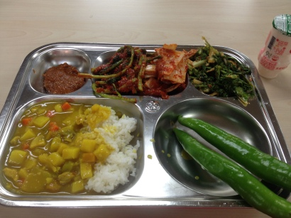 Peppers dipped in ssamjang, radish stem and napa kimchi, soy sauce lettuce salad, rice with yellow curry