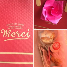 """Small prezzie for Mini. The """"rose"""" (I tried) was a note, plus some cookies, maple syrup, a lip stain from Canada, etc."""